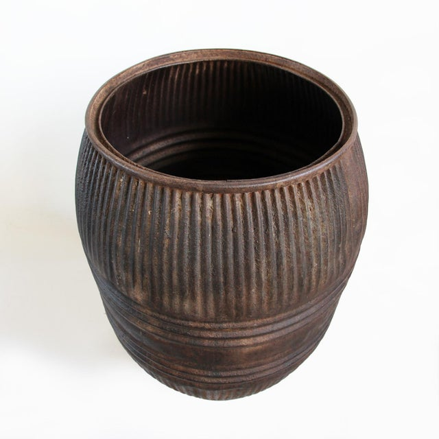 Vintage iron grain barrel from North India. Solid construction, great for display or functional container for plants and...
