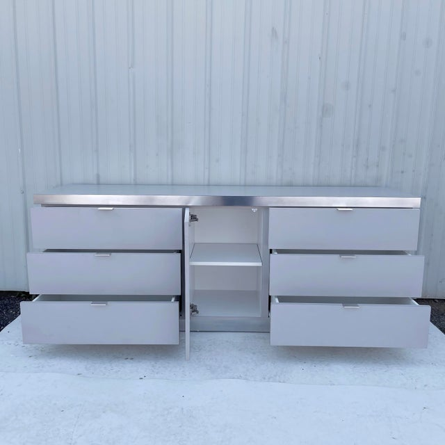This impressive vintage modern bedroom dresser features unique retro style in formica like finish with brushed aluminum...