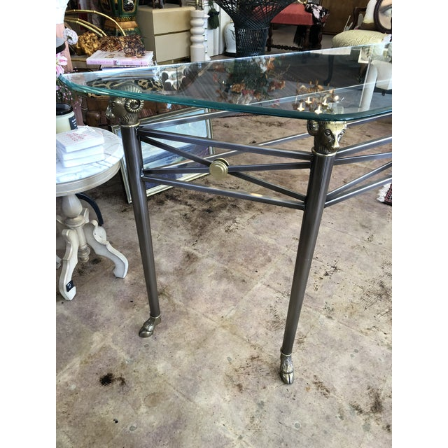Ram heads & hoof feet Hollywood Regency Italian console table in the style of Maison Jensen. Made of brushed nickel and...