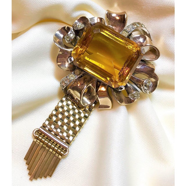 Retro design, circa 1940s Kreisler gold, plated sterling silver brooch prong set with a large, faceted topaz glass center...