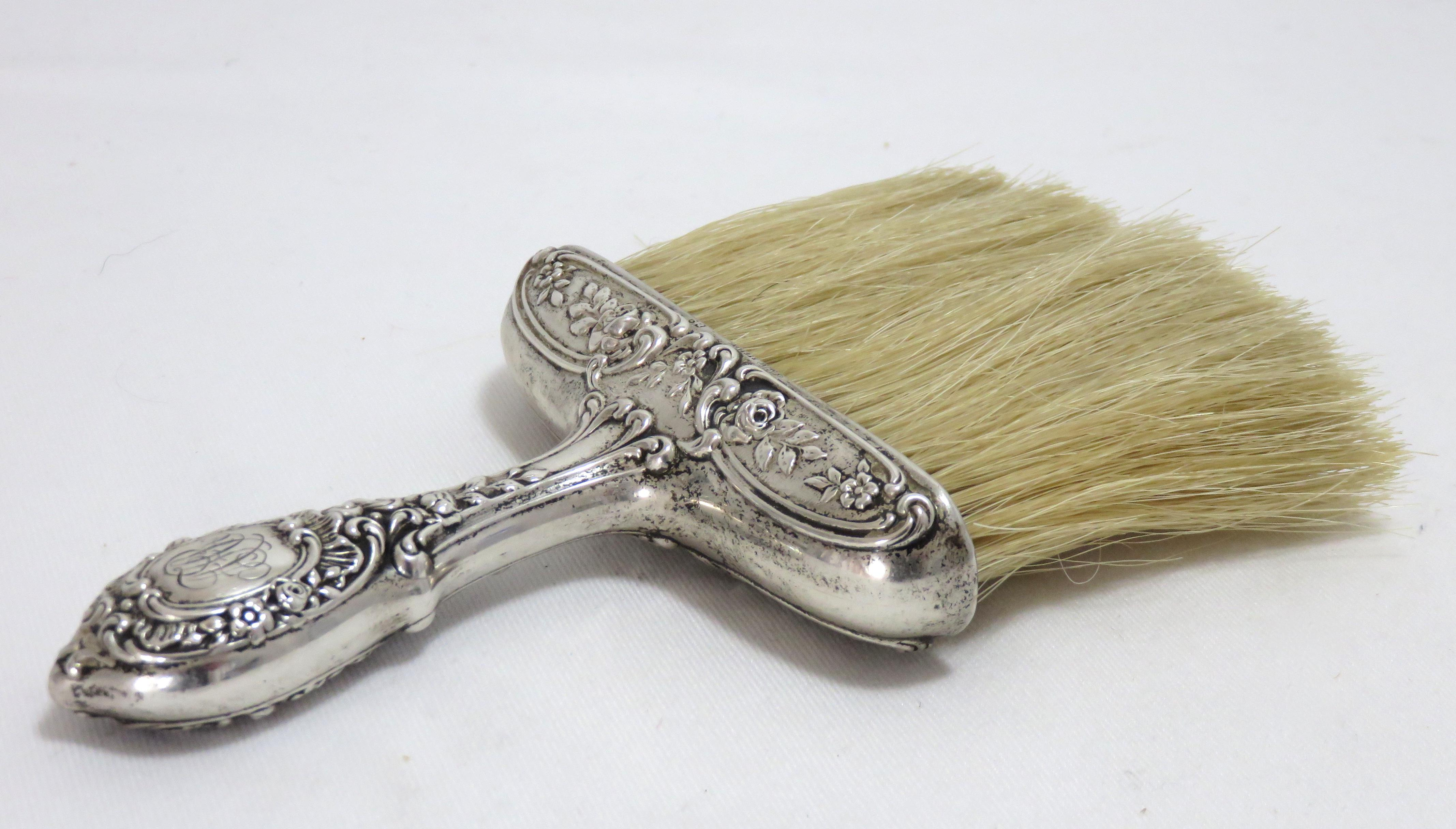 A Fancy Victorian Sterling Silver Handle Table Crumb Brush. Circa 1900. It  Has A