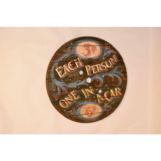Early 20th century hand painted commercial spool wheel from England which has been hand painted as a carnival sign.