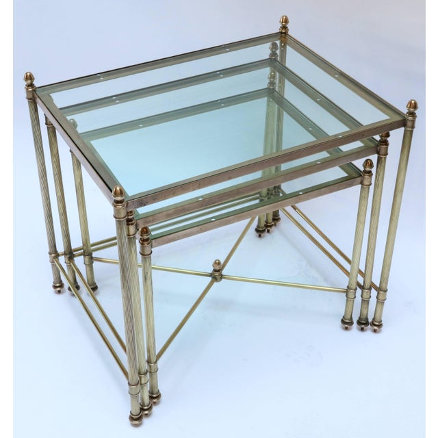 Set of three 1960s Italian brass nesting tables with finials and decorative details. Large: 19in x 14in x 18.5in high...