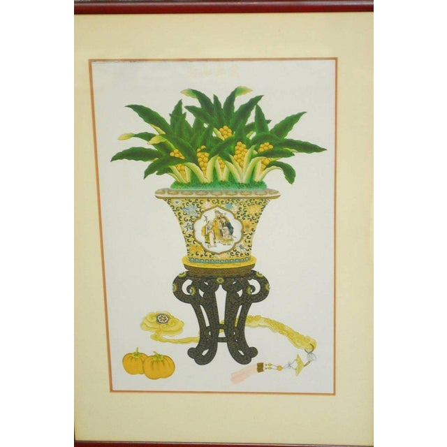 Colorful pair of Chinese flora and foliate still life prints featuring highly decorated porcelain cachepots with gilt...