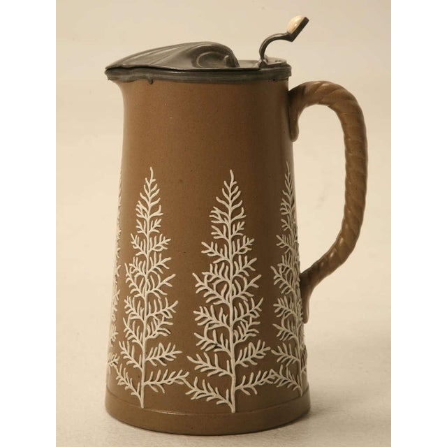 Probably made by Wedgwood, this stellar antique English jug oozes with quality. Mocha colored basaltware stylishly...