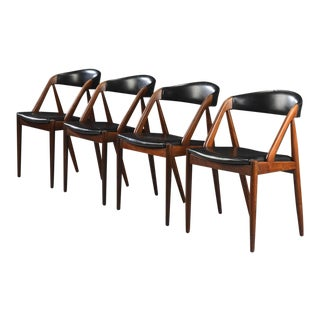 Set of Four Rosewood Danish Modern Dining Chairs by Kai Kristiansen For Sale