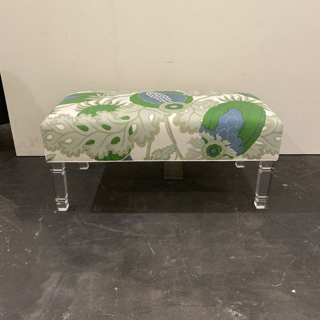 Custom made bench with designer fabric. Lucite legs for a fun modern twist.