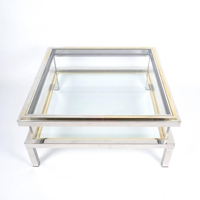 Very elegant 1970s French chrome and glass table with brass accents to the glass top. Very solid quality 35 inch table...