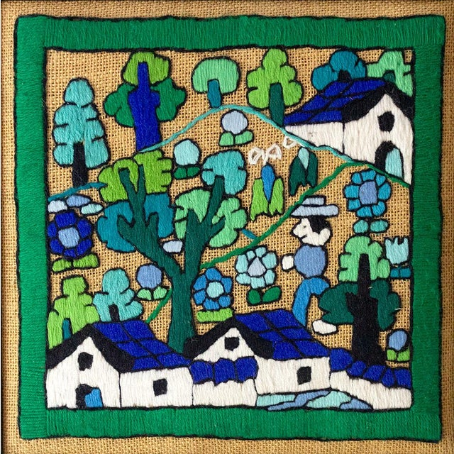A unique piece of folk art hand embroidery, for a collage or gallery wall. This piece has a gorgeous cool-toned color...