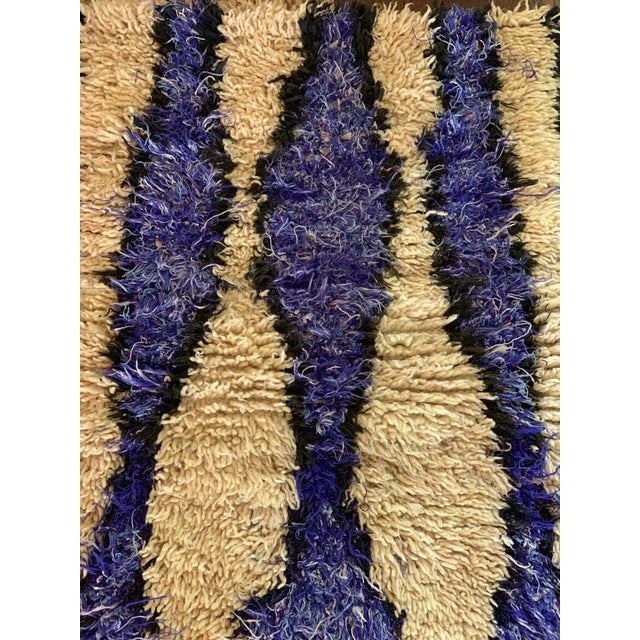 Authentic vintage Moroccan Berber craft Azilal rug. Striking color combination of blue, purple, cream and black. Azilal...