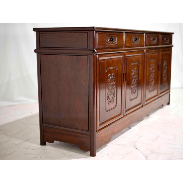 Decorative solid rosewood effect finish chinoiserie sideboard. This buffet is constructed with four drawers and four...