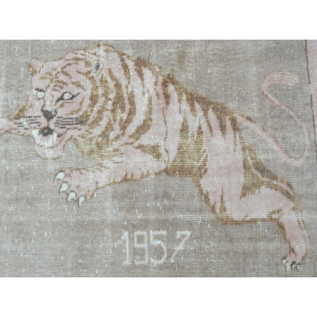 A vintage hand-knotted Gabbeh rug with a pictorial and lion design. This rug has a very soft pile, natural colors and an...