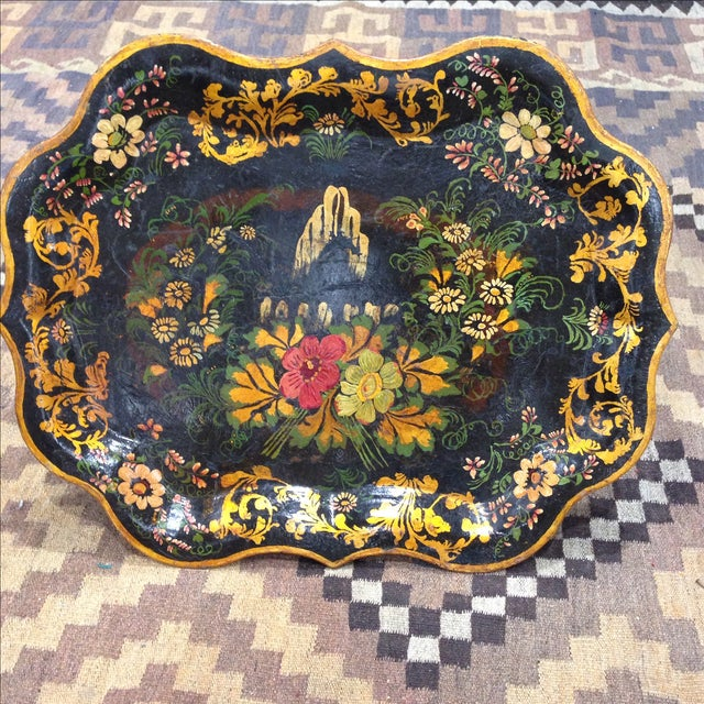Add elegant flavor to your contemporary decor with this antique scalloped tin tray. Gold gilt edges and details.