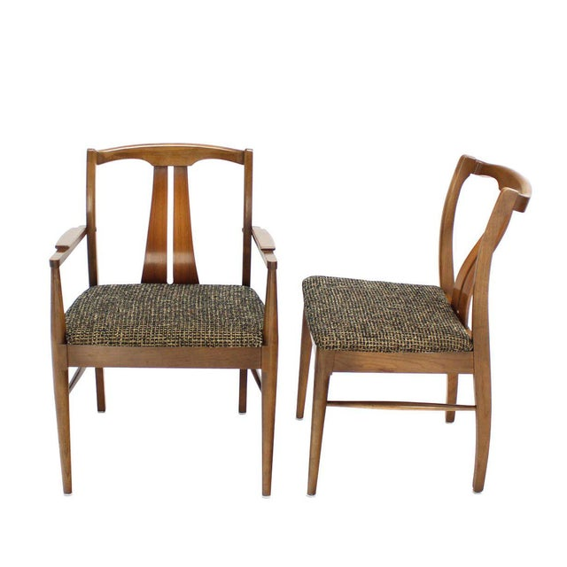 Set of six Mid-Century Modern dining chairs with curved backs and new upholstery.