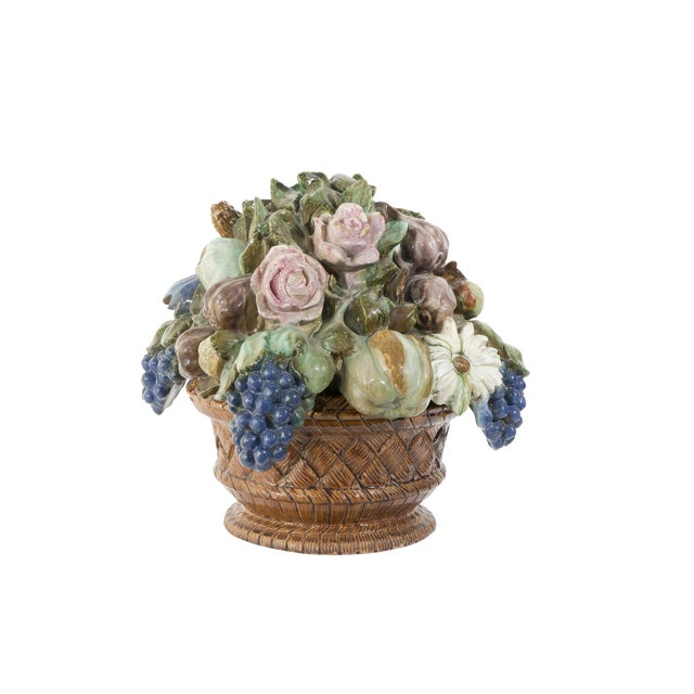 A stunning pair of antique terra cotta fruit and flower baskets from France. They are glazed, detailed and display...