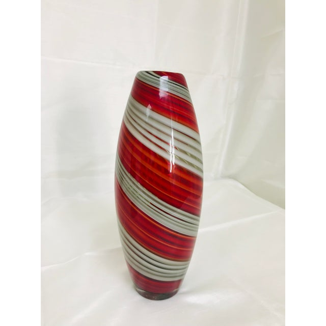Contemporary art glass vase in a red & grey swirl with polished pontil. Made in the 2010s.