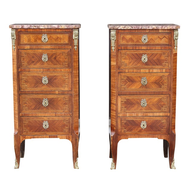 Each with brocatelle marble tops over five drawers flanked by chamfered corners with bronze mounts, slight cabriole legs...