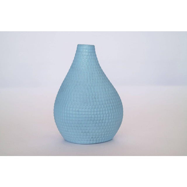 """Three sky blue vases with scale like texture. Smaller vase measure in at, H 7"""" D 3"""" W 5"""""""
