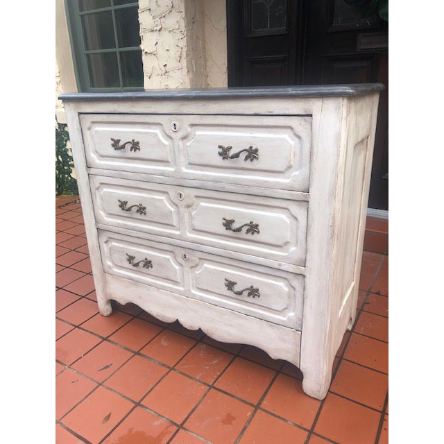 19th century white painted distressed chest. Charcoal gray faux marble top. 3 drawers, French hardware, straight lines....