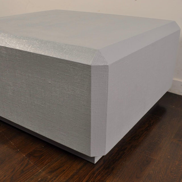 Medium size lacquered grass cloth table in the manner of Springer. Heavy and very well built. Lacquered in a light gray.