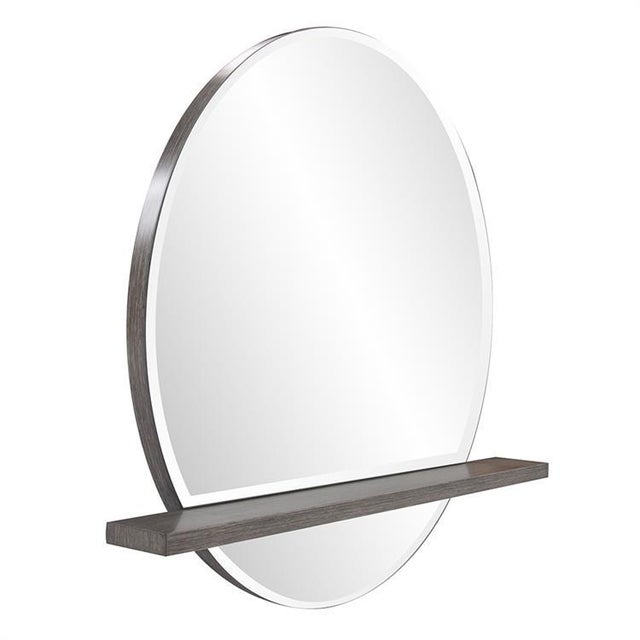 Our Winston Mirror perfectly illustrates both form & function. The simple round wood frame is only visible from the side....