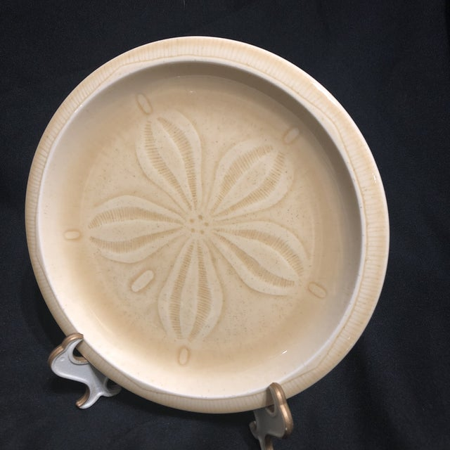Included are five dinner plates, four salad plates and three saucers. The designs on the plates include: Conch Sand Dollar...