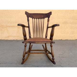 Early 1900s Press Back Rocking Chair With New Leather Seat Preview