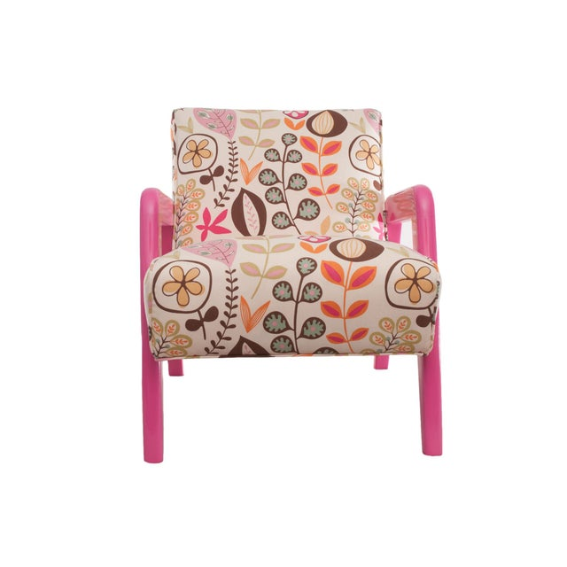 "An Atomic chair dressed in a ""Mod"" floral design, and painted in a bright berry-pink lacquer. The upholstery has been..."