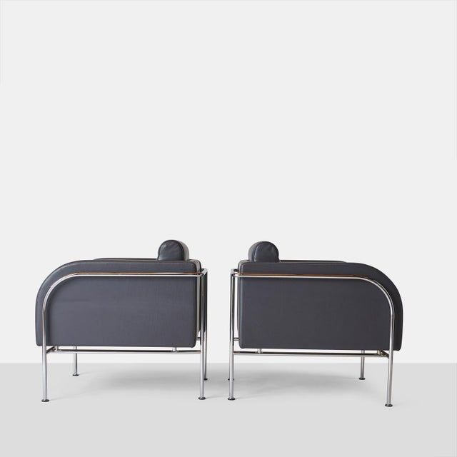 Pair of lounge chairs by Friis & Moltke. A pair of curved arm lounge chairs for Randers Mobelfabrik. From the 'Series 2000...