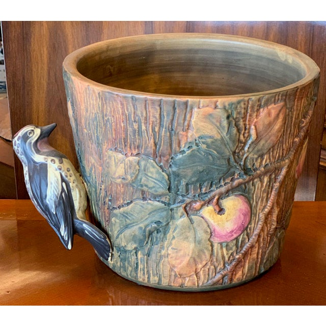 Weller Pottery Woodcraft/ Baldin pattern jardiniere with woodpecker. A red capped woodpecker makes his home on this Weller...