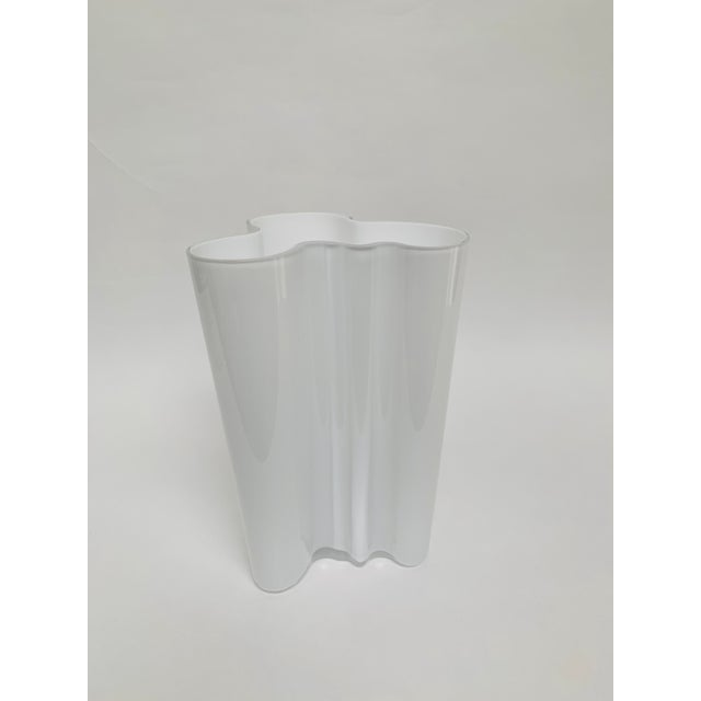 This iconic amorphic glass vase is one of a series of vases created by Alvar and Aino Aalto for the Savoy Helsinki hotel...