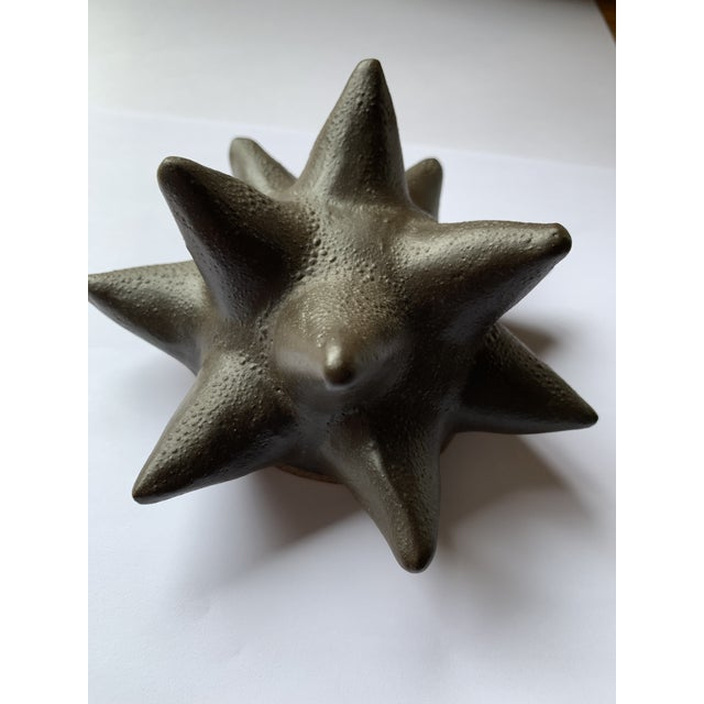 This is a lovely textured black ceramic art object in the form of a sea urchin or star. Perfect as a desk accessory or...