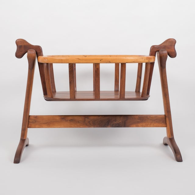 An American-made organic modern bassinet by Illinois-based craftsman Ejner Pagh. The bassinet has a wide lip in a...