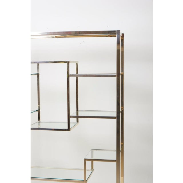 Very huge and rare brass and tinted glass bookshelf or étagère by Romeo Rega. The étagère is in good condition and a...