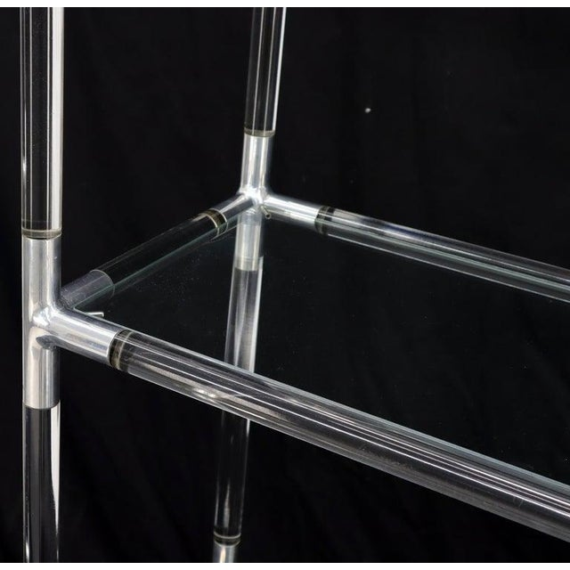 Mid-Century Modern 5-tier Lucite and glass etagere. Possibly designed by Charles Hollis Johnes.