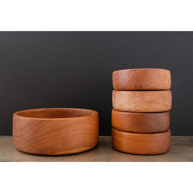 Set of Goodwood Teak Bowls. 5 pieces, including one large serving bowl with 4 smaller individual bowls. Modern lines and a...