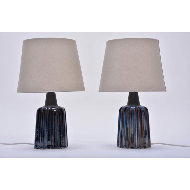 This pair of table lamps was produced by Danish company Soholm Stentoj in the 1970s. The lamps are stoned and glazed in...