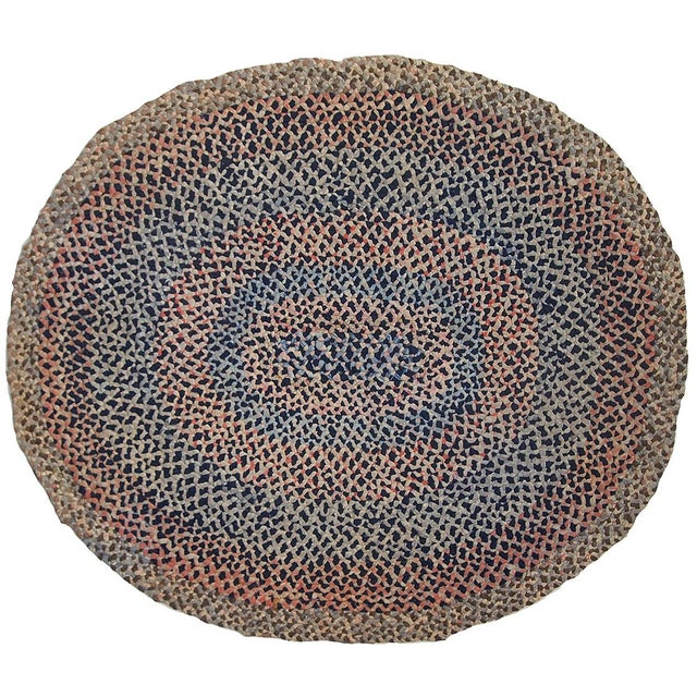 Antique American Braided handmade oval rug in original good condition. It is made out of cotton stripes in different...