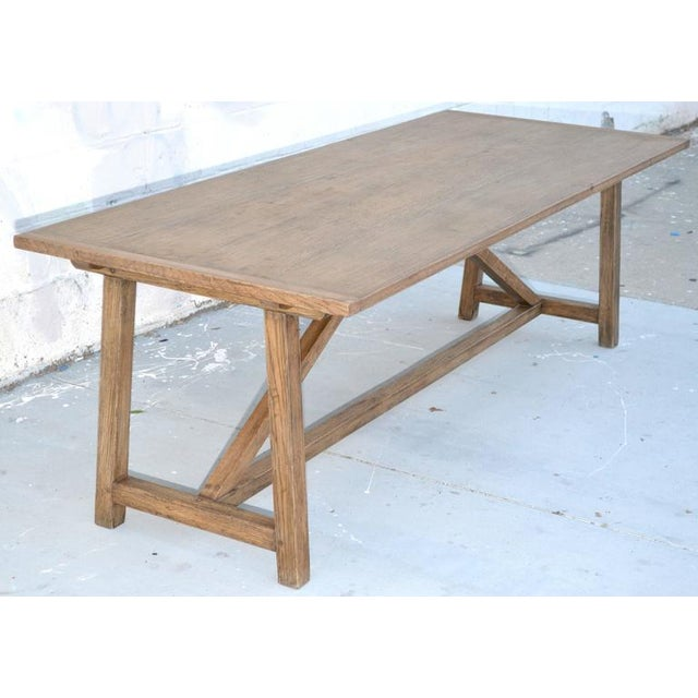 "Custom dining table in distressed, rift-sawn, white oak. As shown here: 75"" x 36"" x 30"" size. This table expands by..."