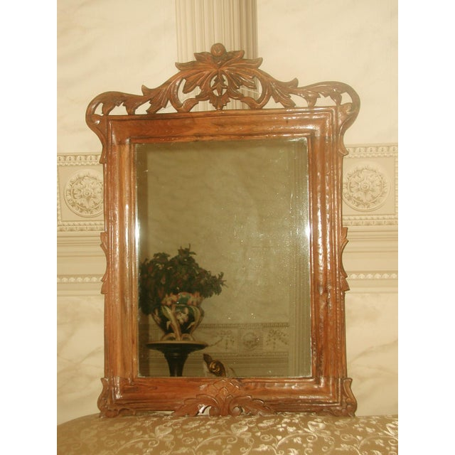 Hand carved wooden mirror from 19th century is of very handsome wood either fruitwood or hickory. Tiny chisel marks seen...
