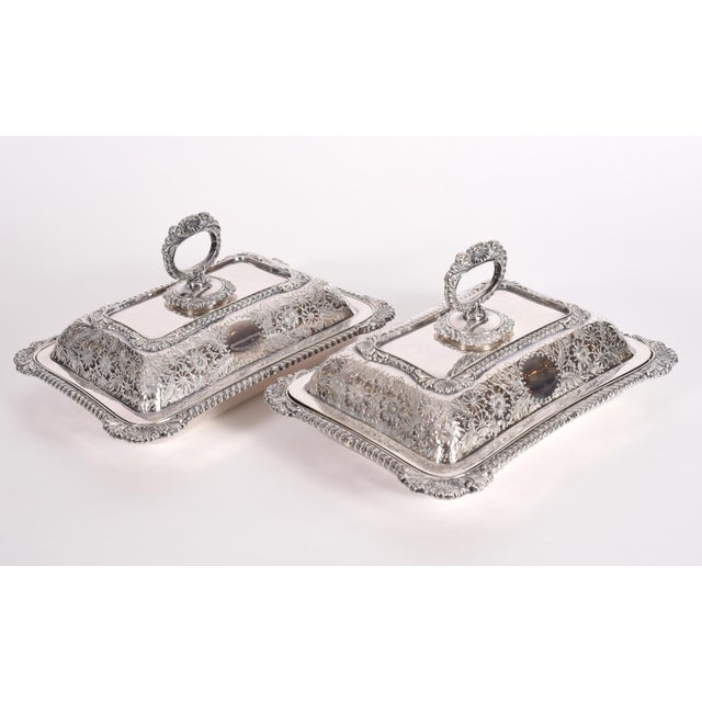 English pair of silver plated / copper tableware serving dishes with an ornately floral repousse design details with a...