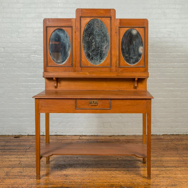 A vintage Indonesian woman's vanity from the mid-20th century, with oval glass panels, single drawer and lower shelf....