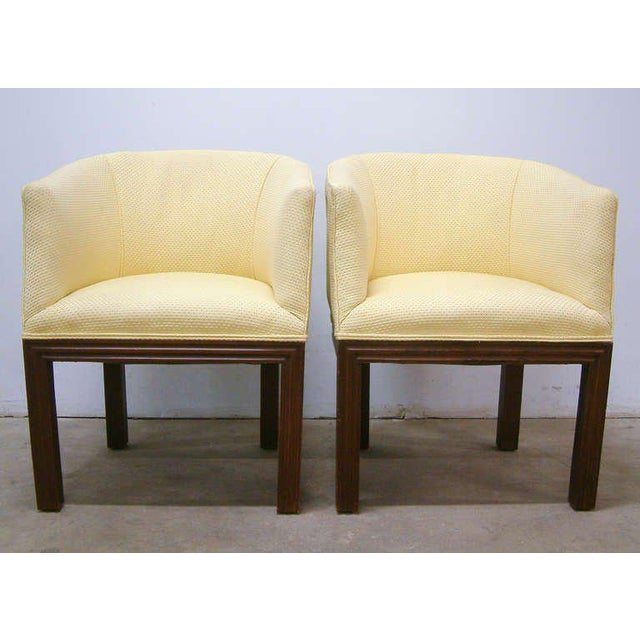 Pair of Walnut Upholstered Arm Chairs Circa 1950 United States Circa 1950 A fine pair of dark-stained walnut arm chairs...