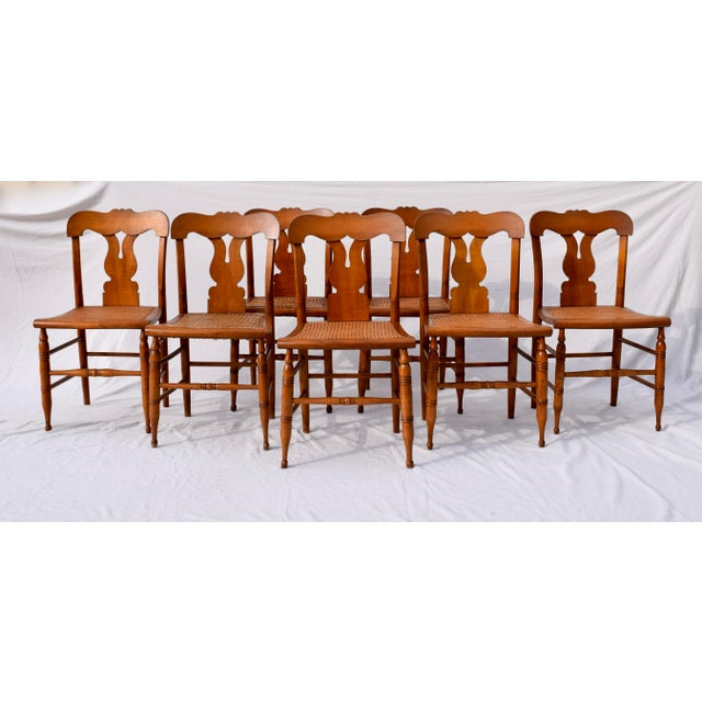 An exceptionally well preserved set of eight Federal period caned maple dining chairs fully detailed & lovingly...