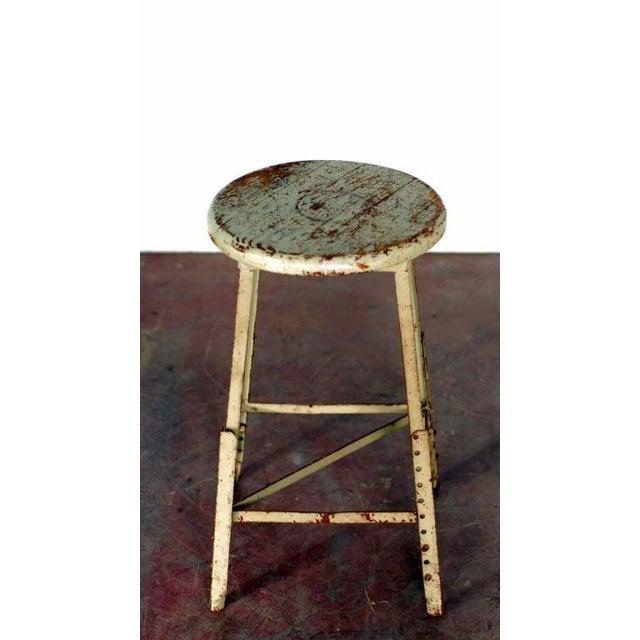 Pair of industrial adjustable bar stools. 24 in. tall +8 in. / 2 in. 14 in. seat diameter.