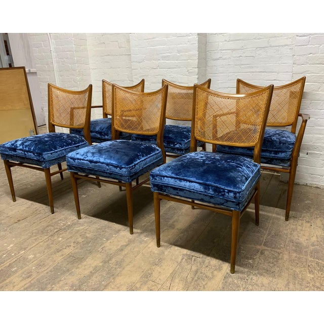 Set of 6 Erno Fabry Walnut and Cane Back Dining Chairs. The chairs are walnut with caned backs. Seats are blue velvet....
