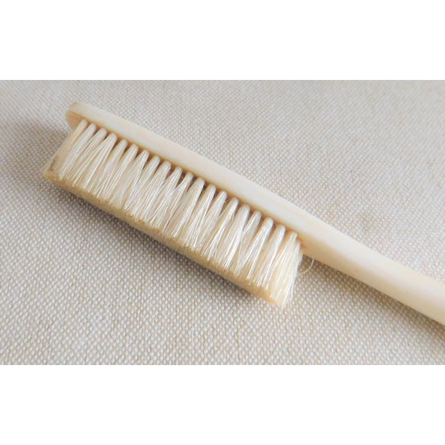 This wonderfully simple antique 19th century bone and natural bristle hat brush was used to keep many a women's and gent's...