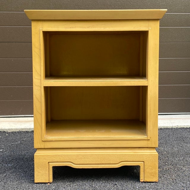 A quality mid century nightstand by Tomlinson with two open shelves. Other matching pieces available.