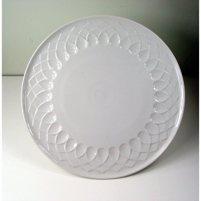 A clean and contemporary white porcelain serving plate, made in Germany. It's in excellent vintage condition.