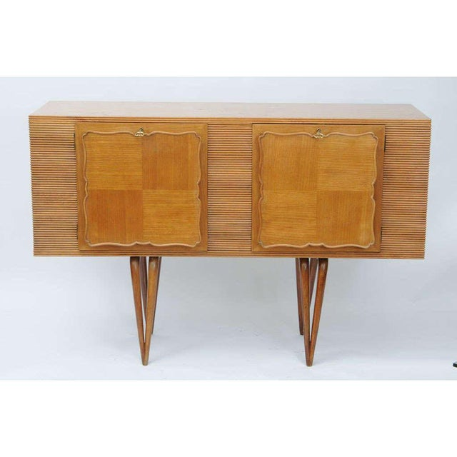 Wonderful delicate little sideboard. Great for a small space. It has four downward tapered legs giving a very elegant,...